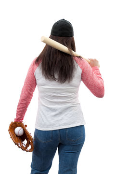Active mature woman and baseball mom concept with attractive brunette female coach wearing a cap, raglan shirt, softball bat and catchers glove seen from the back, isolated on white with clipping path