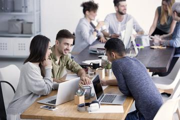 Happy team brainstorming in office