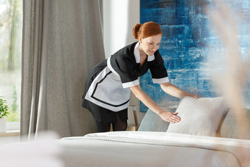 Professional maidservant in hotel