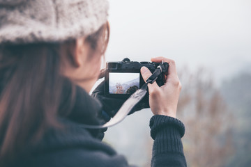 Photographer take a photo landscape nature with digital mirrorless camera. vintage style.