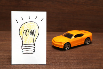 自動車と電球のイラスト 電気自動車イメージ
