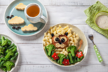 Funny Lion Food Face with Cutlet, Pasta and Vegetables