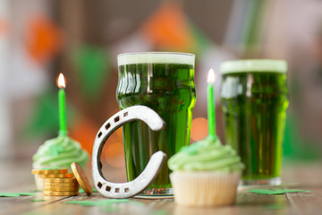 glass of beer, cupcakes, horseshoe and gold coins
