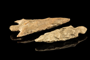 Two Indian arrowheads and black background
