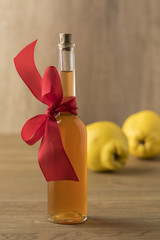 Botlle with homemade quince liqeur as a gift