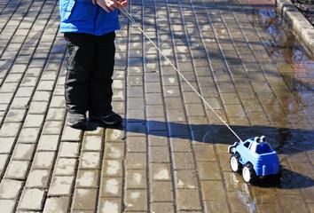 Boy with a toy car.