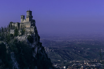 San Marino fortress landscape at dusk. Purple night sky
