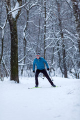 Photo of male skier in woods in winter