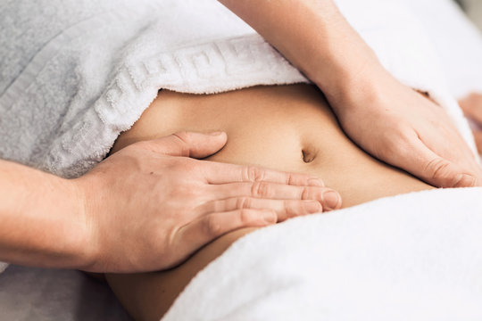 Professional massage of the abdomen.