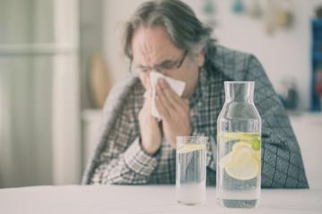 Flu senior man with blanket