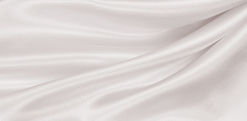 Smooth elegant golden silk or satin luxury cloth texture as wedding background. Luxurious Christmas background or New Year background design. In Sepia toned. Retro style