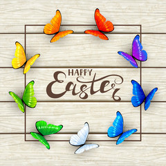 Easter lettering and butterflies on white wooden background
