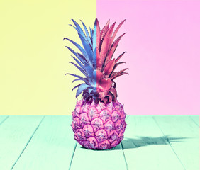 Tropical Pink Pineapple Fruit. Vanilla Pastel Color. Creative Minimal. Hot Summer Vibes. Sunny Beach background. Trendy fashion Style.
