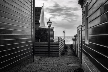Black and white photo of a hamlet with its typical wooden houses on the island of Marken in the Netherlands
