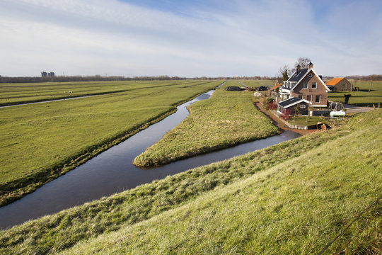 Dutch polder landscape with a farm and some houses