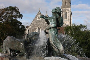 View of famous Gefion Fountain (Gefionspringvandet 1899) in Copenhagen. Gefion Fountain depicting legendary Norse goddess driving four oxen. It was designed by Danish artist Anders Bundgaard. Denmark.