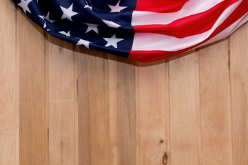 The Flag Of The United States Of America. American flag on a light wooden background. The place to advertise, template.