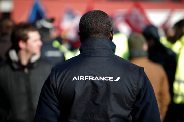 Air France employees demonstrate outside the French airline headquarters in Roissy-en-France, north of Paris