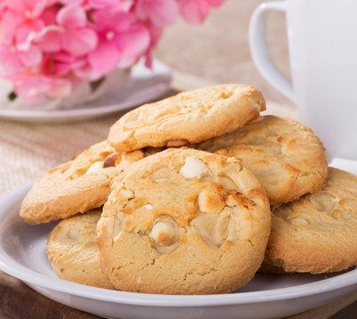 Closeup of a plate of macadamia nut, white chocolate cookies