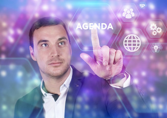 Business, Technology, Internet and network concept. Young businessman working on a virtual screen of the future and sees the inscription: Agenda
