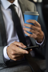 businessman using his smartphone in a car