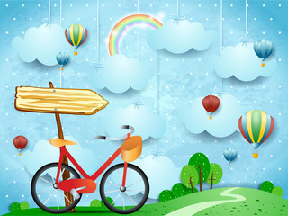 Wall Murals Light blue Surreal landscape with hanging clouds, arrow sign and bike