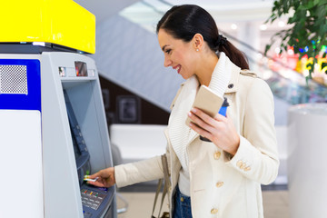Woman withdrawing cash at an ATM