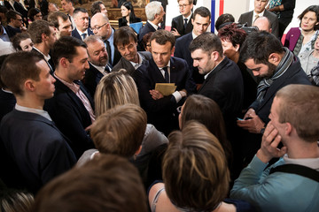 French President Emmanuel Macron speaks with guests after he delivered a speech to the young French farmers invited at the Elysee Palace before the opening of the 2018 Paris International Agricultural Show in Paris