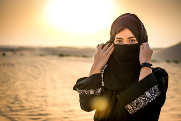 Portrait of beautiful Muslim woman wearing Hijab in the desert.
