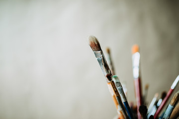 Close-up image of a group of artist's paint brushes