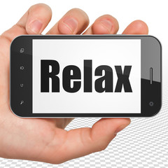 Holiday concept: Hand Holding Smartphone with black text Relax on display, 3D rendering