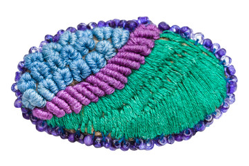 hand made knitted brooch isolated on white