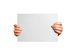 Hands holding a grey clean blank sheet of A4. Isolated on grey background