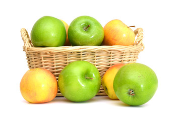 Red and green apples in basket on white background