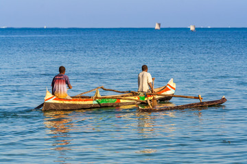 Malagasy fishermen rowing