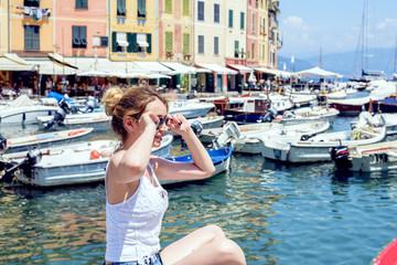 Woman portrait in Portofino, Italy. Beautiful day at the port views