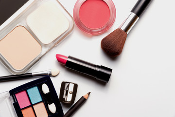 cosmetics on white background top view.