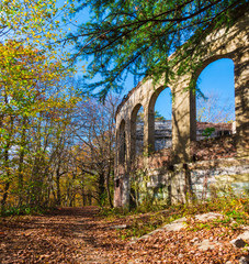 Abandoned building of the former restaurant on the top of Mount Akhun in sunny autumn day, Sochi, Russia