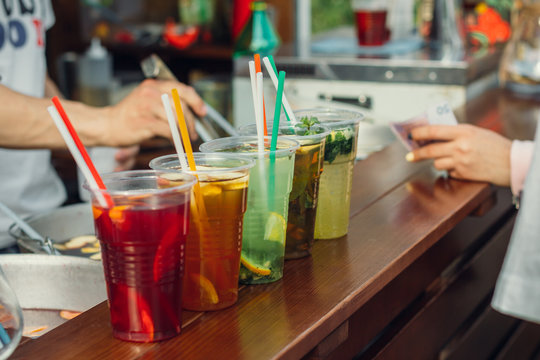 Lemonade in plastic cups in fast food cafe