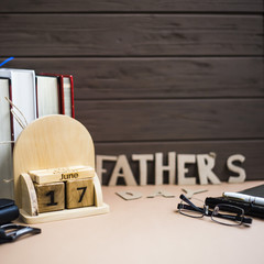 Father's Day. Men's accessories on a beige background. International holiday on June 17, 2018