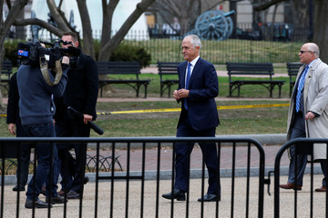Turnbull speaks with Australian reporters in front of the White House in Washington