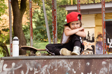 little girl skateboarding. hobby. sport