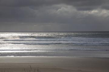 Sunbeams on stormy ocean