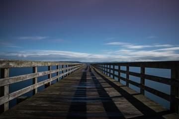 Long pier boardwalk over water