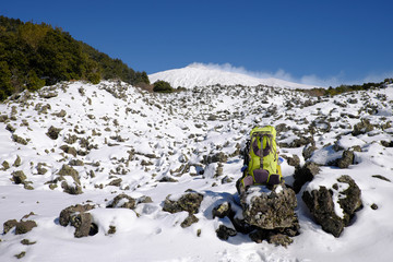 Wall Mural - Green Backpack On Winter Etna Mount, Sicily