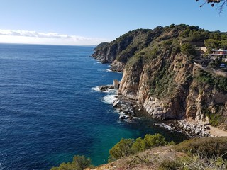 Rocky high bank, precipice. The dark blue Mediterranean Sea. View from the cliff.