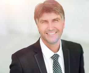 Portrait of a smiling successful businessman.