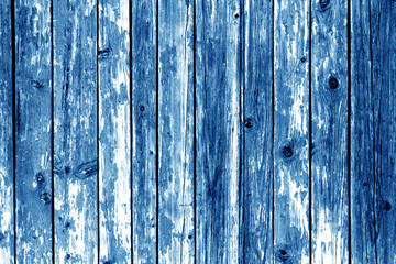Grungy wooden wall background in navy blue color.