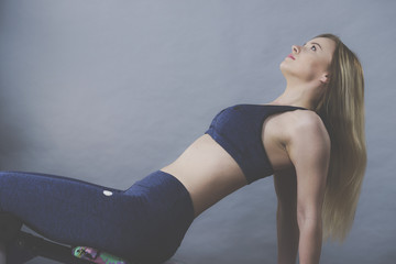 Woman training on bench for sit ups