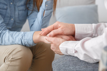 Female psychologyst therapy session with client indoors sitting support close-up